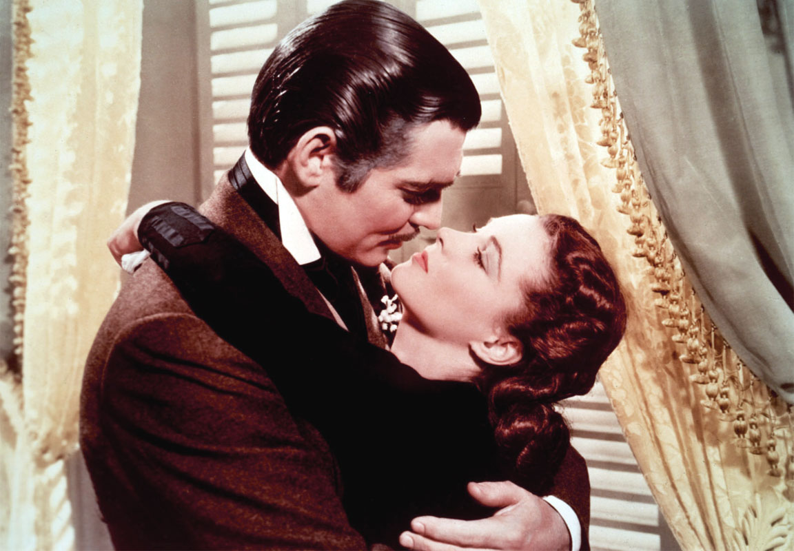 Clark Gable e Vivien Leigh, in una scena del film Via col vento