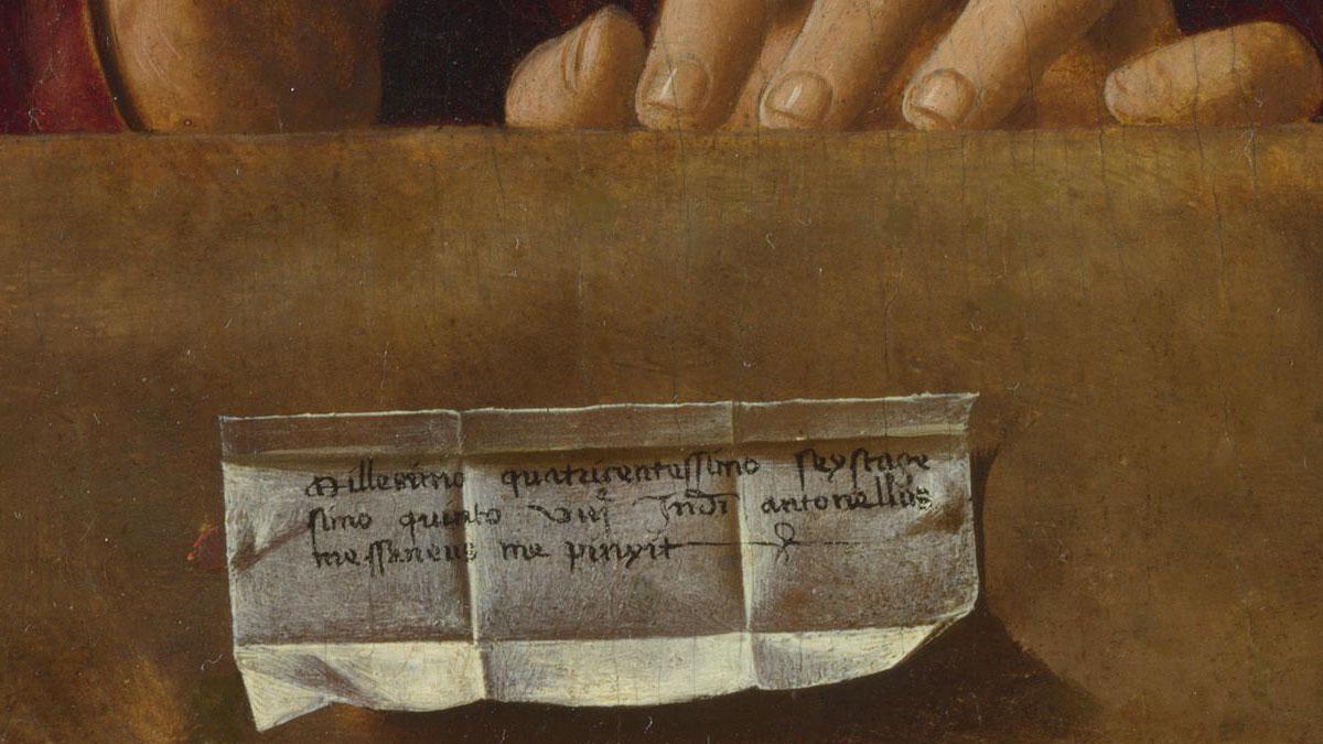 Salvator Mundi: dettaglio delle dita di Gesù con la scritta di Antonello da Messina